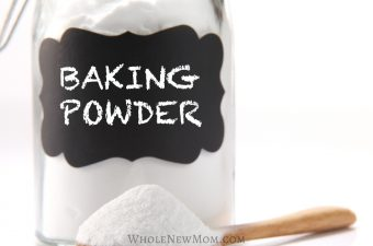 aluminum-free baking powder in a glass jar with a wooden spoon