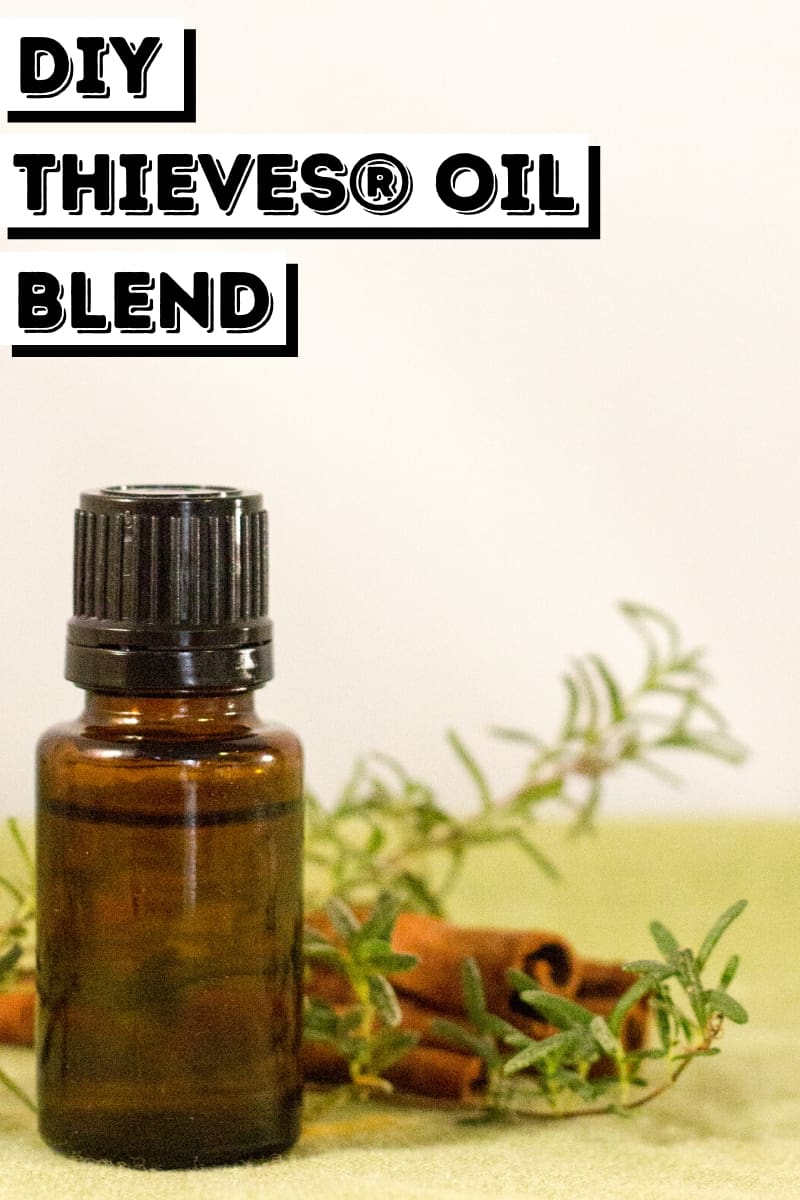 essential oil bottle with rosemary and cinnamon for DIY Thieves® Oil Blend