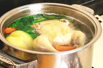 homemade chicken broth in a stainless pot