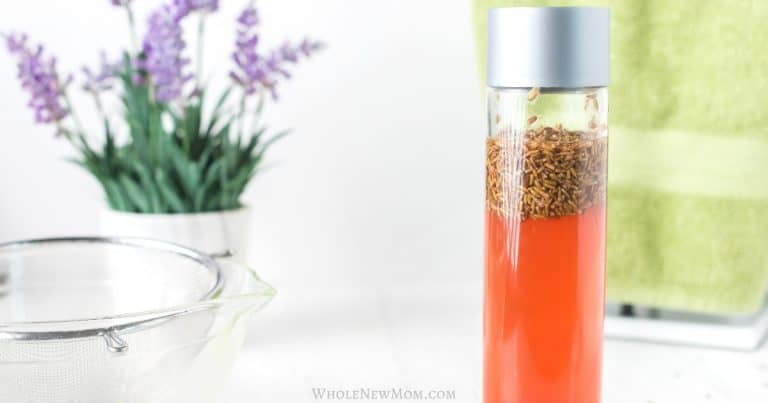 homemade apple cider vinegar hair rinse in a glass bottle with lavender
