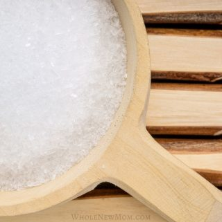 epsom salt in wooden cup for post about uses for epsom salt