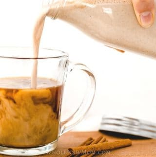 vegan pumpkin spice creamer being poured into glass mug