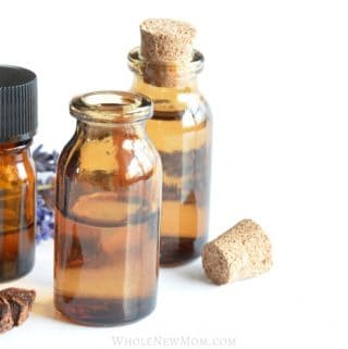 3 essential oils bottles with anise and corks and lavender