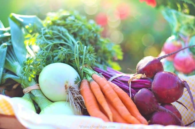 bunches of red beets, carrots, and onions