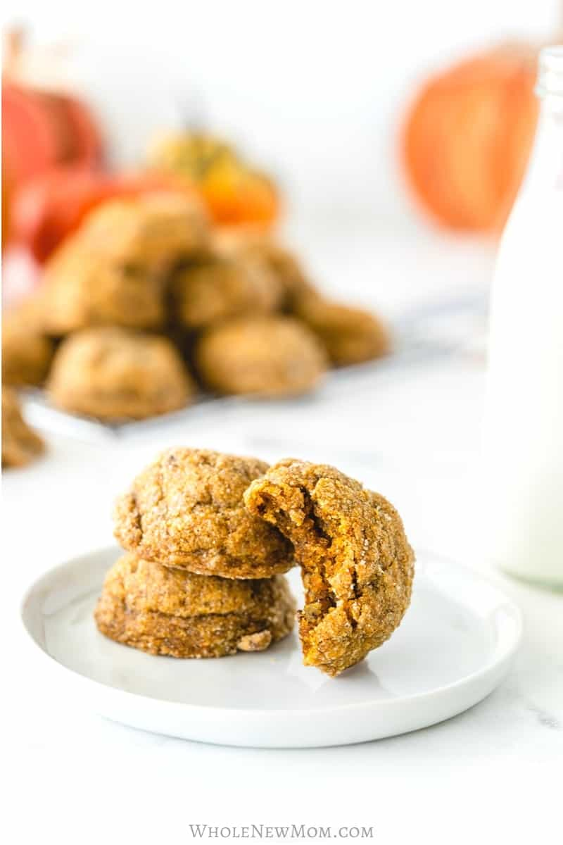 Pumpkin pecan cookies on white plate with jar of milk on white table