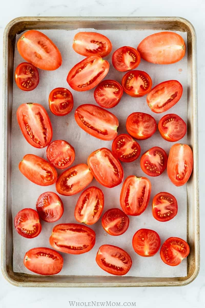 tomato halves on baking sheet covered with parchment paper