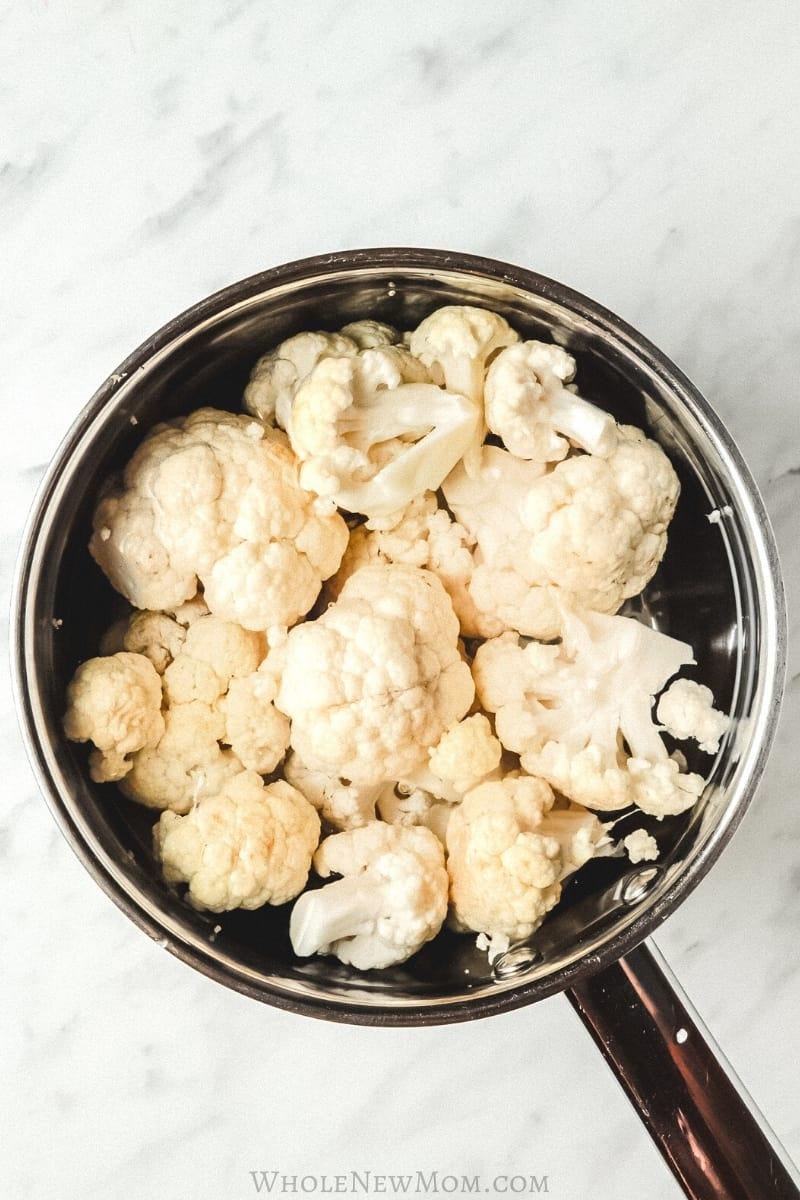 cauliflower and water in saucepan