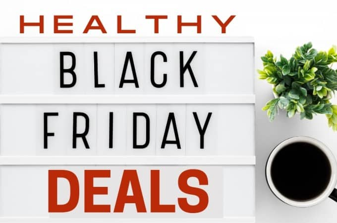 white board with healthy black friday deals written on it with tiles / cup of coffee on the side