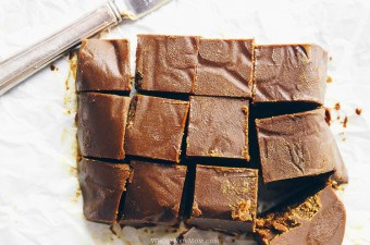 healthy fudge on white parchment paper with knife in background