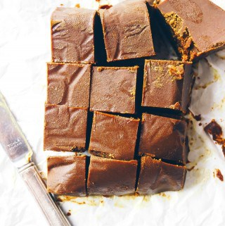 healthy fat fudge on white parchment paper with knife