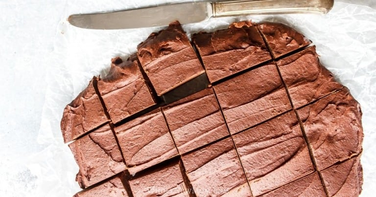 bean fudge with knife on white parchment paper