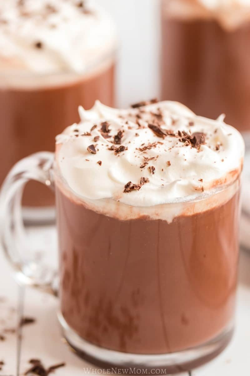 hot chocolate with wiped cream in glass mug