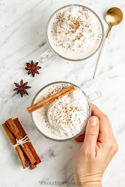keto eggnog in glass mugs with cinnamon sticks