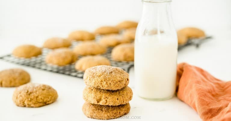 pumpkin snickerdoodle cookies with jar of milk and cooling rack in background