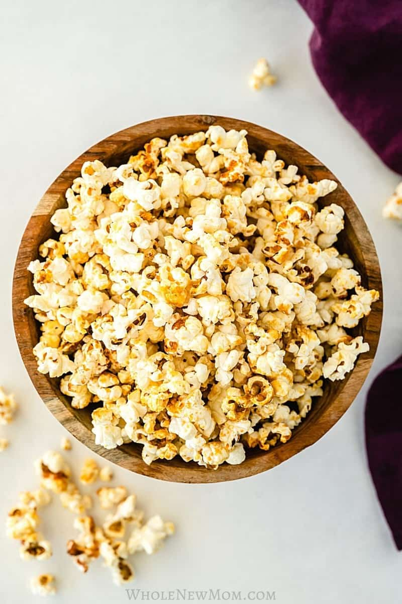 overhead view of kettle corn in wooden bowl