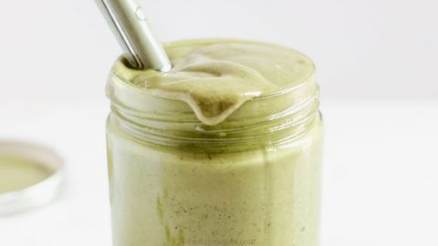 homemade pumpkin seed butter in glass jar with spoon