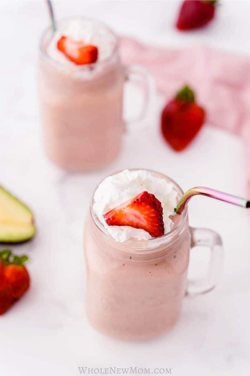 strawberry avocado smoothie in mason jar mugs
