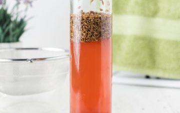 homemade apple cider vinegar hair rinse in a glass bottle