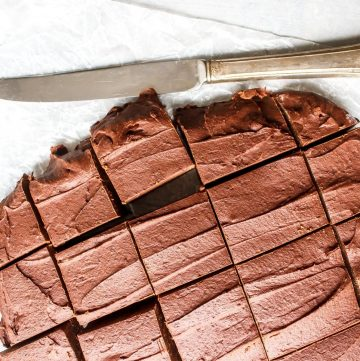 sliced bean fudge and a knife on a white parchment paper