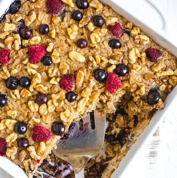 oatmeal cake in a baking dish with a serving fork