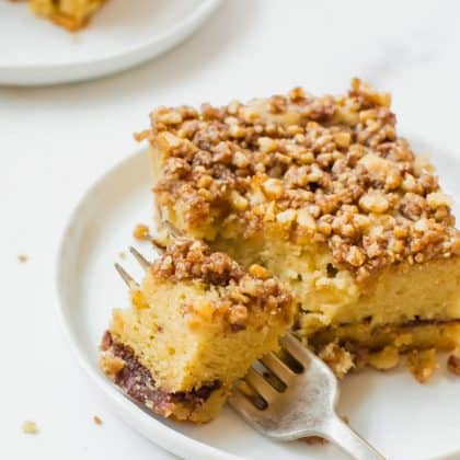 piece of keto coffee cake on white plate with fork