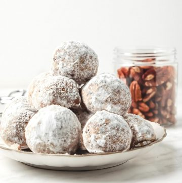 pile of snowball cookies on a plate