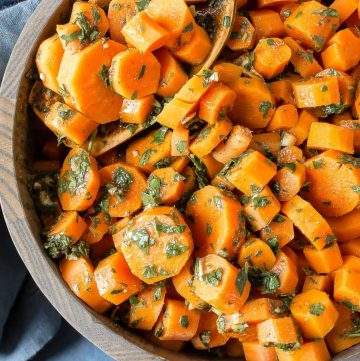 moroccan carrots in a wooden bowl with wooden spoon