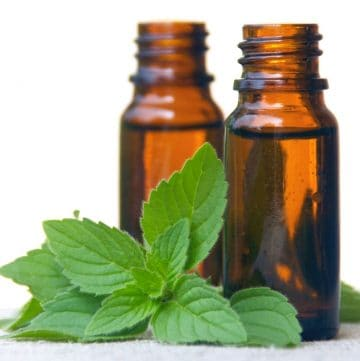 peppermint leaves with amber bottles in the background