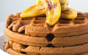 teff waffles topped with banana slices