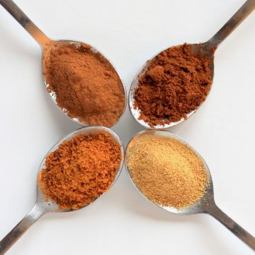 pumpkin pie spices in stainless spoons