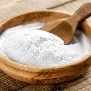 baking soda in wooden cup with wooden spoon