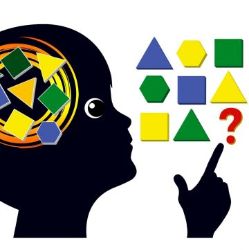 child thinking of different shapes and colors