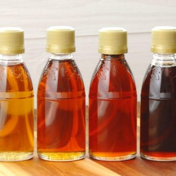 varying grades of maple syrup in a bottle