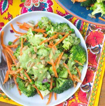 broccoli jicama salad on a plate with fork