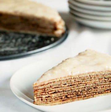 slice buckwheat crepe cake on a white plate