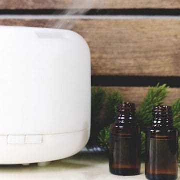 diffuser and two bottles of essential oil
