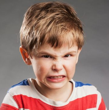 little boy making face
