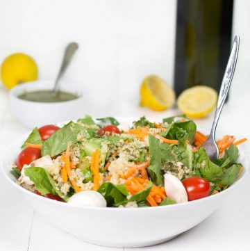 garden quinoa salad in a bowl with fork