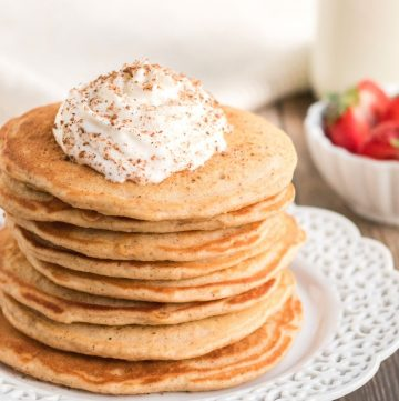 eggnog pancakes topped with whipped cream