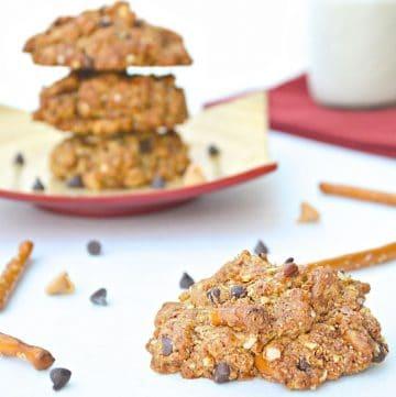 kitchen sink cookies with choco chips and pretzels around it