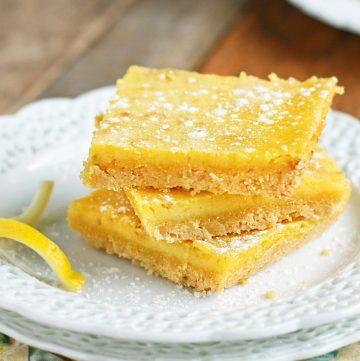 lemon bars on white plate