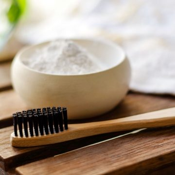 toothbrush and tooth powder in a bowl