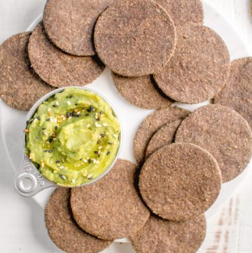 lentil crackers and dip on a plate