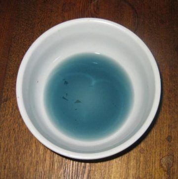 blue food coloring in a small bowl