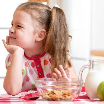 little girl refusing her food