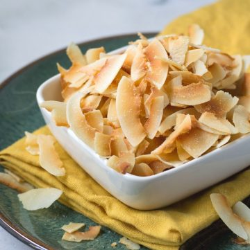 homemade coconut chips in white square bowl