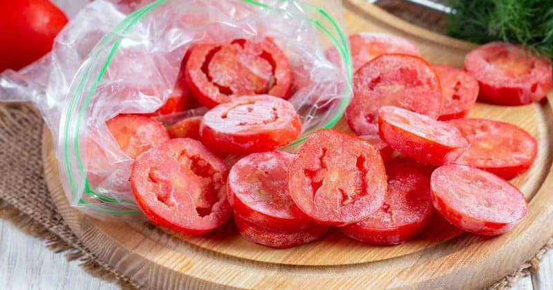 frozen sliced tomatoes on cutting board
